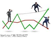 Businessman balancing on tightrope on line chart. Стоковое фото, фотограф Elnur / Фотобанк Лори