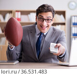 Businessman with american football in office. Стоковое фото, фотограф Elnur / Фотобанк Лори