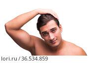 Man doing his hair isolated on white. Стоковое фото, фотограф Elnur / Фотобанк Лори