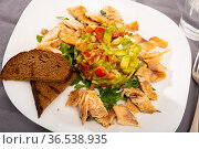 Grilled trout fillet served with salad guacamole with fresh tomatoes. Стоковое фото, фотограф Яков Филимонов / Фотобанк Лори