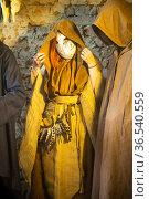 Masked and cassocked monk performs ritual pagan rite. Стоковое фото, фотограф Евгений Ткачёв / Фотобанк Лори