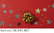 Christmas decorations with stars and snow patterns on red background. Стоковое видео, агентство Wavebreak Media / Фотобанк Лори