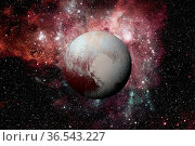 Solar System - Pluto. It is a dwarf planet in the Kuiper belt, a ring... Стоковое фото, фотограф Zoonar.com/Irina Dmitrienko / easy Fotostock / Фотобанк Лори