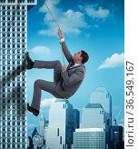 Businessman in challenge concept climbing skyscraper. Стоковое фото, фотограф Elnur / Фотобанк Лори