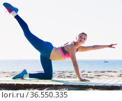 Fitness woman is practicing set of stretching exercises. Стоковое фото, фотограф Яков Филимонов / Фотобанк Лори