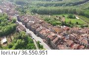View from drone of spanish village Hostalric with Parish church of Santa Maria. Стоковое видео, видеограф Яков Филимонов / Фотобанк Лори