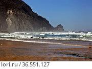 Portugal Ursa Beach at atlantic coast of Atlantic Ocean with rocks and foam at sand of coastline picturesque landscape panorama. Пляж на мысе Рока. Португалия (2011 год). Стоковое фото, фотограф Oleg Borunov / Фотобанк Лори
