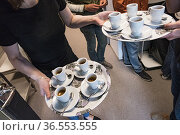 Stockholm, Sweden A man serves espresso coffee on a tray. Стоковое фото, фотограф A. Farnsworth / age Fotostock / Фотобанк Лори