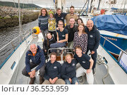Research crew on yacht operated by By The Ocean We Unite Foundation, a Dutch charity exploring microplastics in the North Sea, Inverness, Scotland, UK,  June 2017. Стоковое фото, фотограф SCOTLAND: The Big Picture / Nature Picture Library / Фотобанк Лори