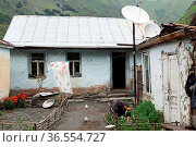 SNO, GEORGIA - JULY 1, 2014: Characteristic homes in the Caucasian... Стоковое фото, фотограф Zoonar.com/Alexander Ludwig / age Fotostock / Фотобанк Лори