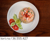 Top view Thai food shrimp fried rice isolated on wooden table. Стоковое фото, фотограф Zoonar.com/Piotr Stryjewski / easy Fotostock / Фотобанк Лори