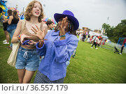 A happy, diverse group of girl friends hang out in the midway at ... Стоковое фото, фотограф Lori Epstein / age Fotostock / Фотобанк Лори