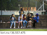 A happy, diverse group of girl friends hang out at the county fair... Стоковое фото, фотограф Lori Epstein / age Fotostock / Фотобанк Лори
