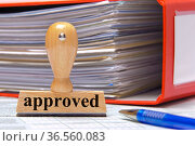Rubber stamp in office marked with approved. Стоковое фото, фотограф Zoonar.com/Wolfilser / easy Fotostock / Фотобанк Лори