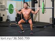 Strong men bodybuilder doing overhead with heavy barbell in modern... Стоковое фото, фотограф David Herraez Calzada / easy Fotostock / Фотобанк Лори