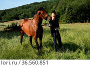 Junger Reiter. Стоковое фото, фотограф Zoonar.com/Martina Berg / easy Fotostock / Фотобанк Лори