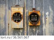 Two old electrical boxes sit empty of fuses and unused outside rusting... Стоковое фото, фотограф Zoonar.com/Christopher Boswell / easy Fotostock / Фотобанк Лори