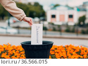 Woman throws sheet with word depression into trash can. Psychology... Стоковое фото, фотограф Zoonar.com/Max / easy Fotostock / Фотобанк Лори