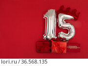 Foil balloons with number 15 fifteen red background. Стоковое фото, фотограф Ekaterina Demidova / Фотобанк Лори