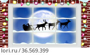 Digital image of fairy light on wooden fame against black silhouette of santa claus in sleigh be. Стоковое фото, агентство Wavebreak Media / Фотобанк Лори