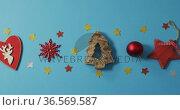 Video of homemade christmas decorations with stars on blue background. Стоковое видео, агентство Wavebreak Media / Фотобанк Лори