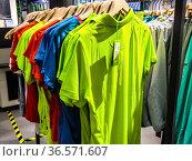 Colorful garments displayed in a sport shop in Bolzano, Bozen, Dolomites... Стоковое фото, фотограф Angelo Calvino / age Fotostock / Фотобанк Лори