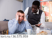 African man soothing offended friend. Стоковое фото, фотограф Яков Филимонов / Фотобанк Лори