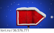 Digital image of snow flakes falling over red wooden sign post against blue background. Стоковое фото, агентство Wavebreak Media / Фотобанк Лори