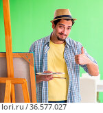 The young male artist working on new painting in his studio. Стоковое фото, фотограф Zoonar.com/Elnur Amikishiyev / easy Fotostock / Фотобанк Лори