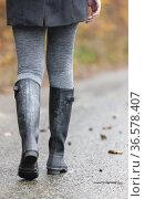 Detail woman wearing black wellingtons. Стоковое фото, фотограф Richard Semik / easy Fotostock / Фотобанк Лори