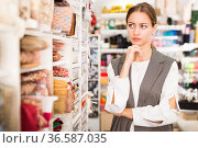 Pensive woman in sewing supplies shop. Стоковое фото, фотограф Яков Филимонов / Фотобанк Лори