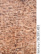 Brown and black brick wall. Close-up. High quality photo. Стоковое фото, фотограф Zoonar.com/Nadtochiy Vladimir / easy Fotostock / Фотобанк Лори