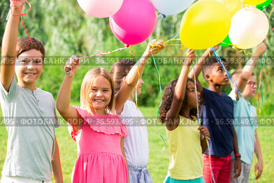 Children with balloons on field