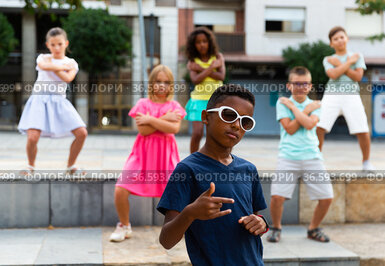 Group of kids performing street dance outdoors