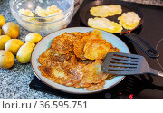 Frying potatoes pancakes during cooking in frying pan. Стоковое фото, фотограф Яков Филимонов / Фотобанк Лори