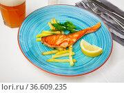 Deliciously steak of baked salmon with french fries. Стоковое фото, фотограф Яков Филимонов / Фотобанк Лори