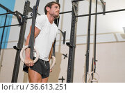 Young Male Athlete exercising With Gymnastic Rings In The Gym. High... Стоковое фото, фотограф David Herraez Calzada / easy Fotostock / Фотобанк Лори