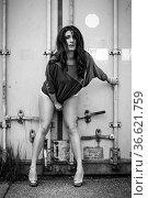 Junge Frau streift durch einsames Industriegelände. Стоковое фото, фотограф Zoonar.com/Eder Christa / age Fotostock / Фотобанк Лори