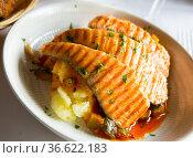 Dish of tasty grilled salmon marinated in sauce with potatoes served. Стоковое фото, фотограф Яков Филимонов / Фотобанк Лори