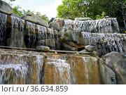 Waterfall in a mineral spring I Resort Spa in Nha Trang in Vietnam... Стоковое фото, фотограф Zoonar.com/BUTENKOV ALEKSEY / easy Fotostock / Фотобанк Лори