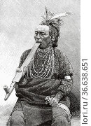 American Indian Native redskin man smoking a pipe at Jardin d'Acclimatation... Редакционное фото, фотограф Jerónimo Alba / age Fotostock / Фотобанк Лори