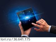 Businessman holding a foldable smartphone with PRIVACY ALERT inscription... Стоковое фото, фотограф Zoonar.com/rancz / easy Fotostock / Фотобанк Лори
