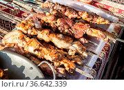 Grilled appetizing kebab on metal skewers. Shashlik made of cubes... Стоковое фото, фотограф Zoonar.com/Alexander Blinov / easy Fotostock / Фотобанк Лори