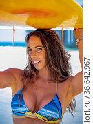 A beautiful brunette bikini model her surfboard on a beach. Стоковое фото, фотограф Zoonar.com/Walter G Arce Sr Grindstone Media/ASP I / easy Fotostock / Фотобанк Лори