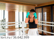 Beautiful young Asian woman kick boxer ready for exercise in gym. Стоковое фото, фотограф Zoonar.com/Toni Rantala / easy Fotostock / Фотобанк Лори