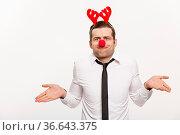 Christmas Concept - Handsome Business man wearing reindeer hairband... Стоковое фото, фотограф Zoonar.com/Phongthorn Hiranlikhit / easy Fotostock / Фотобанк Лори