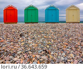 Vintage British Beach Huts On A Stony Shore With Wintry Sky With Copy... Стоковое фото, фотограф Zoonar.com/Roy Henderson / easy Fotostock / Фотобанк Лори