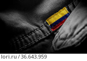Tag on dark clothing in the form of the flag of the Colombia. Стоковое фото, фотограф Zoonar.com/BUTENKOV ALEKSEY / easy Fotostock / Фотобанк Лори