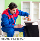Repair contractor repairing broken furniture at home. Стоковое фото, фотограф Elnur / Фотобанк Лори