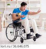 Disabled man watching sports on tv. Стоковое фото, фотограф Elnur / Фотобанк Лори